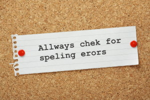 The phrase Always Check For Spelling Errors on a cork notice board, typed with deliberate spelling mistakes as a concept for ensuring business documents and correspondence are checked for errors.