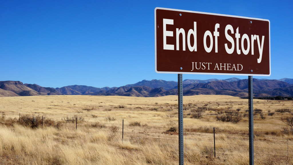 End of Story road sign with blue sky and wilderness